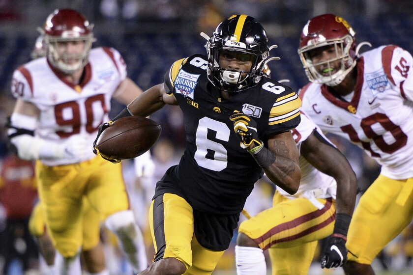 FILE - In this Dec. 27, 2019, file photo, Iowa wide receiver Ihmir Smith-Marsette (6) runs with the ball for a touchdown during the first half of the Holiday Bowl NCAA college football game against Southern California in San Diego. Smith-Marsette knew he messed up when Iowa City police pulled him over after clocking him driving 74 mph in a 30 zone in the wee hours of Nov. 1. His career was not over. In fact, coach Kirk Ferentz offered support, putting out a statement hours later saying the arrest was out of character and that Smith-Marsette was a great teammate. (AP Photo/Orlando Ramirez, File)