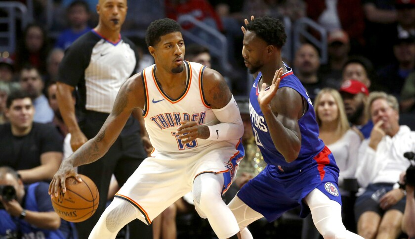 Oklahoma City Thunder's Paul George (13) is defended by Los Angeles Clippers' Patrick Beverley (21)