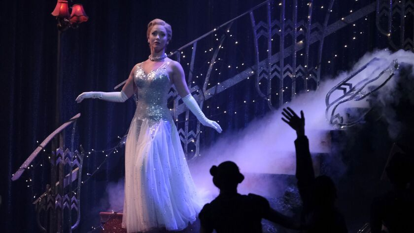 """Cinderella (Ashley Shaw) descends the stairs at the ball in Matthew Bourne's reimagining of """"Cinderella,"""" now at the Ahmanson Theatre in Los Angeles through March 10."""