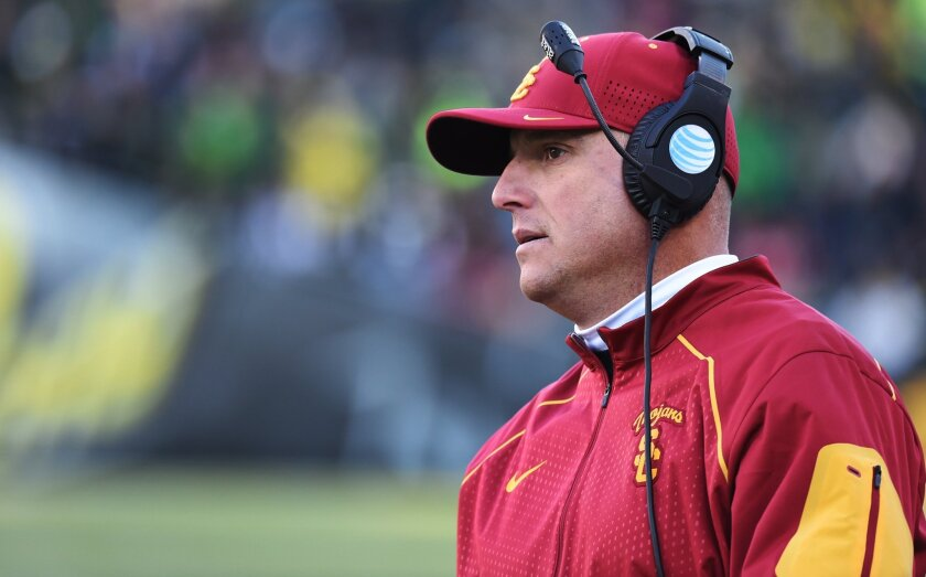 """USC has dropped """"interim"""" from football Coach Clay Helton's title."""