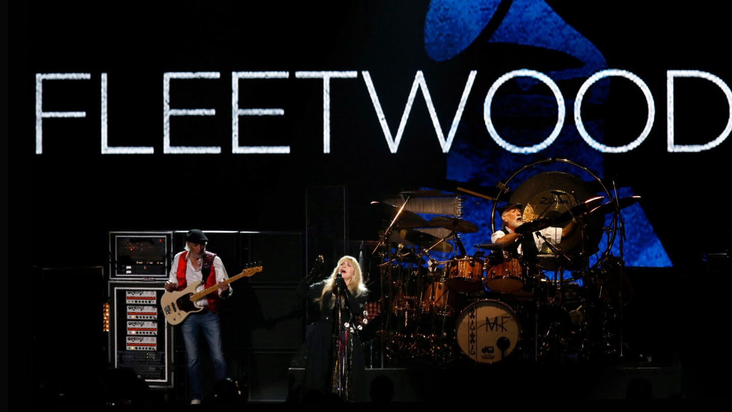 John McVie, left, Stevie Nicks and Mick Fleetwood of Fleetwood Mac perform at Radio City Music Hall in New York on Friday for their MusiCares Person of the Year tribute, the first time a group received the award.