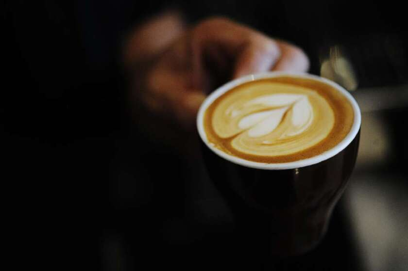 Yeekai Lim prepares a cappuccino at Cognoscenti Coffee at Proof Bakery.