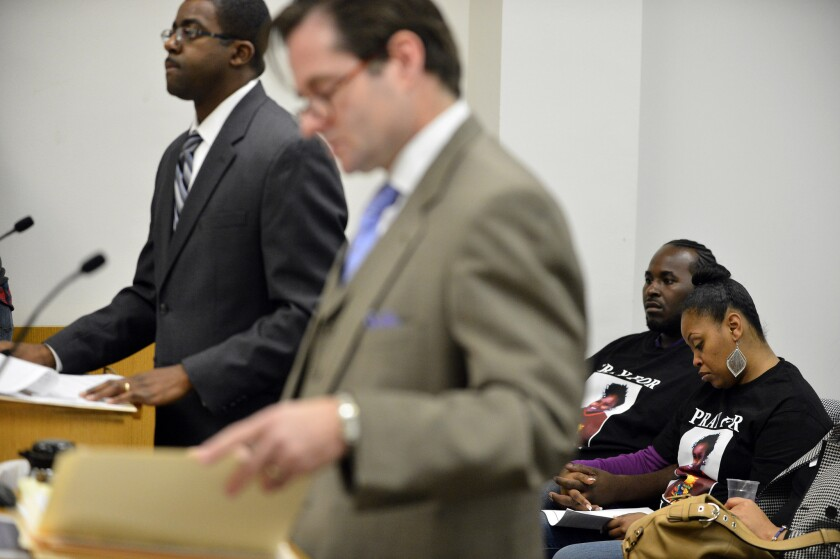 Brian Franklin, left, attorney for Children's Hospital Oakland, and Christopher Dolan, attorney for Nailah Winkfield, mother of Jahi McMath, speaks during a court hearing to discuss the treatment of Winkfield's daughter in Oakland. Among those in the courtroom were Martin Winkfield and wife Nailah Winkfield, behind the attorneys.