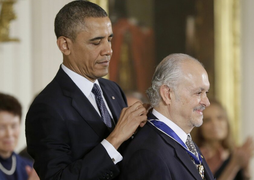 President Barack Obama confers the Presidential Medal of Freedom on UC San Diego chemist Mario Molina Wednesday during a ceremony at the White House.