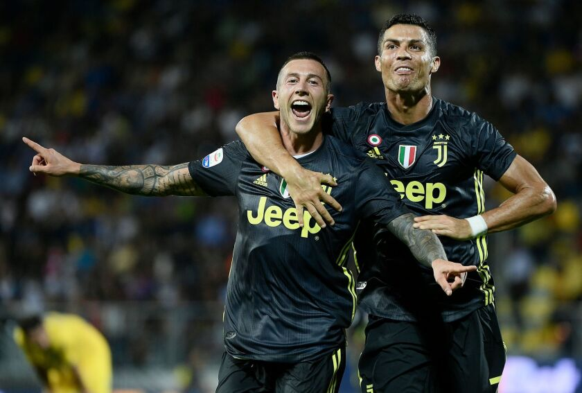 Juventus' Portuguese forward Cristiano Ronaldo (R) celebrates with teammate Juventus' Italian forward Federico Bernardeschi (L) during the Italian Serie A football match between Frosinone and Juventus Turin on September 23, 2018 at the Benito-Stirpe Stadium in Frosinone.