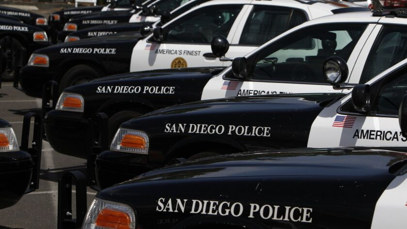 A San Diego police officer and a suspect he was trying to arrest were seriously injured early Thursday after being struck by a car.