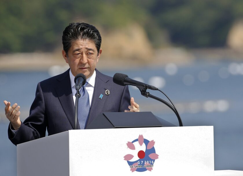 FILE - In this May 27, 2016 file photo, Japanese Prime Minister Shinzo Abe speaks at a press conference at the G-7 summit in Shima, central Japan. Parliament was due to vote later Tuesday, May 31, on a no-confidence motion against Abe put forward by opposition parties. But the Liberal Democratics'