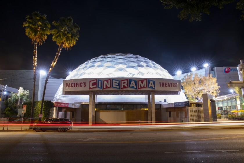 Traffic blurs by a boarded-up Cinerama Dome of the ArcLight Cinemas on Sunset Blvd, in the heart of Hollywood, CA