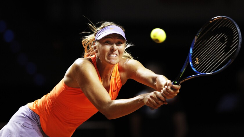 Maria Sharapova lunges for a backhand during her match against Roberta Vinci on Wednesday.