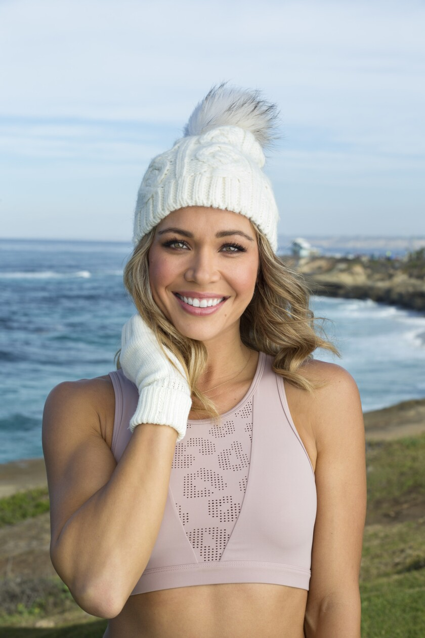 "Former ""Bachelor"" and ""Bachelor in Paradise"" participant Krystal Nielson in La Jolla. She is wearing a Varley rose sports bra, $68; Trouve fingerless gloves $19, all Nordstrom Fashion Valley, and Echo knit hat $99 from Bloomingdales Fashion Valley."