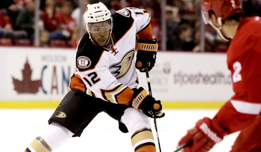 Ducks right wing Devante Smith-Pelly brings the puck up ice against the Red Wings on Saturday.