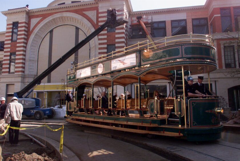 Conductor Greg Schmidt drives a wireless trolley on the inaugural ride at The Grove.