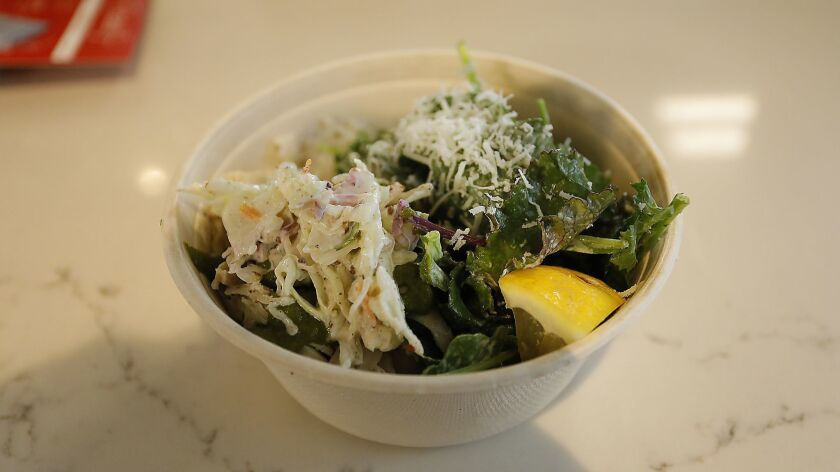 San Diego, CA_7/9/2018_|A bowl of roast chicken, kale and rice from Roast Meat and Sandwich Shop.|