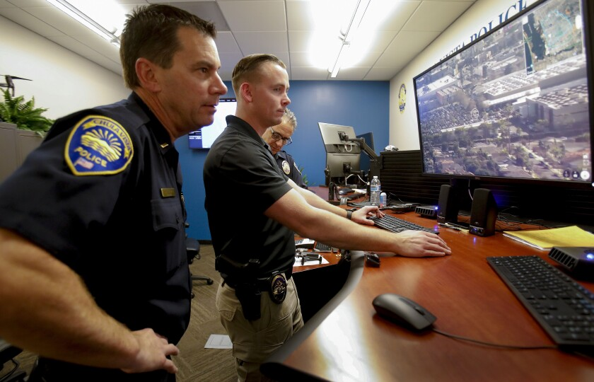 From left: Chula Vista Policemen Don Redmond, Kyle Roberts and Lt. Gino Grippo recently used a drone to investigate a report of domestic violence in the department's Drone First Responder Operations Center.
