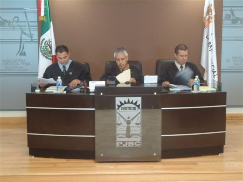 Judge Salvador Morones Pichardo, center was the presiding member of a three-judge panel Friday in a Mexicali courtroom as Baja California that heard the case of an accused car thief.