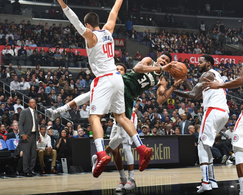 Milwaukee Bucks' Giannis Antetokounmpo handles the ball during a game against the Clippers on Nov. 6 at Staples Center.