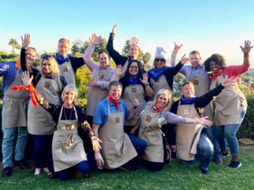Jodi Abel has taught team-building cooking classes like this one for 12 years.
