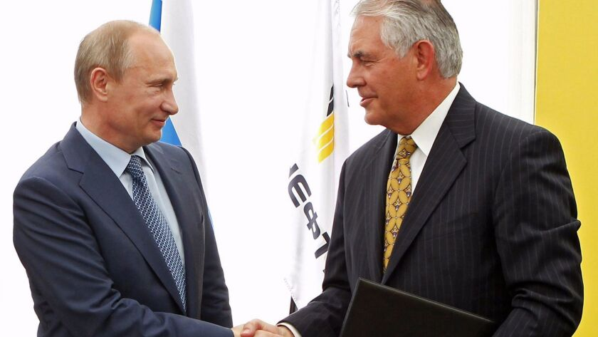 Russian President Vladimir Putin and Exxon Mobil CEO Rex Tillerson shake hands at a ceremony celebrating the signing of an agreement between state-controlled Russian oil company Rosneft and Exxon Mobil, in Russia in 2012.