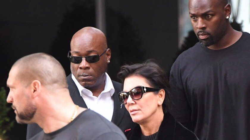 Guards accompany Kris Jenner and Kanye West in New York after Kim Kardashian was robbed at gunpoint in Paris.