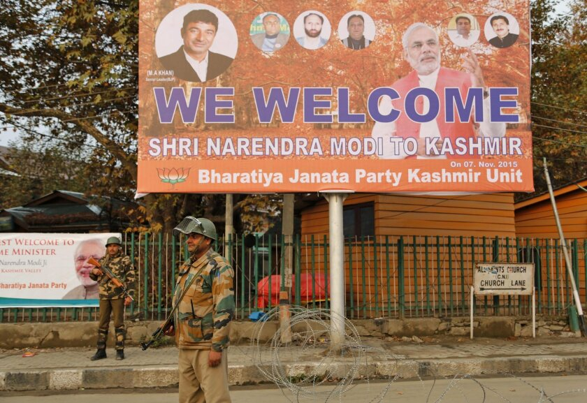Indian paramilitary soldiers guard near the venue of Indian Prime Minister Narendra Modi's scheduled rally in Srinagar, Indian controlled Kashmir, Friday, Nov. 6, 2015. Authorities tightened security dramatically in parts of Indian-administered Kashmir on Friday to prevent protests ahead of a visit