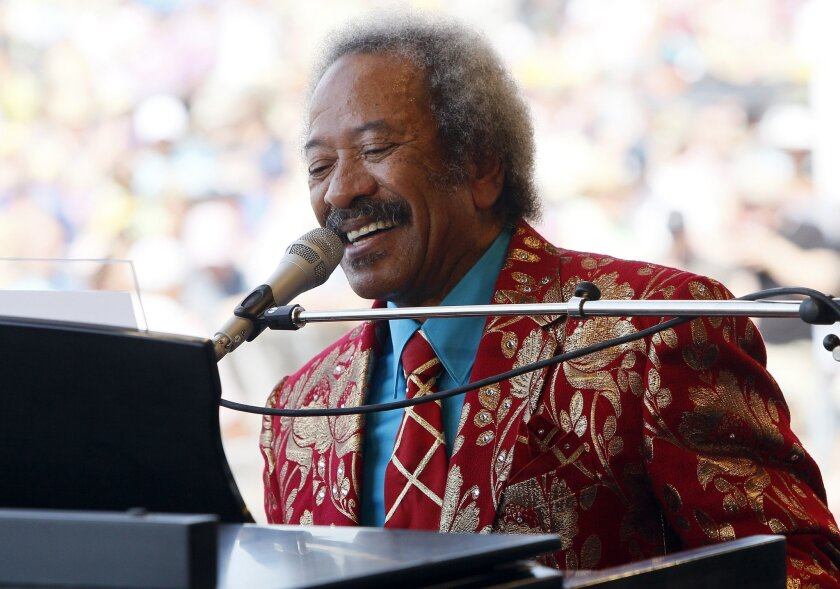 FILE - In this file photo dated Saturday, May 7, 2011, Allen Toussaint performs at the New Orleans Jazz and Heritage Festival in New Orleans, USA. Legendary New Orleans musician Toussaint died after suffering a heart attack following a concert he performed in the Spanish capital, Madrid, after emergency services were called Monday Nov. 9, 2015, to his hotel. (AP Photo/Patrick Semansky, FILE)