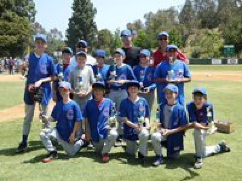 (Left) Majors Champion - Cubs  Back row, left to right: Coach Tom Acierno, Manager John Schreiber, Coach Charles George; middle row, left to right: Markie Scherer, Alex Inscoe, Frank Van Den Berg, Jackie Plashkes, Zack George, Mike Schreiber, Jayden Gillespie; front row, left to right: Dennis Smith