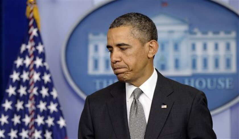 President Barack Obama finishes speaking in the Brady Press Briefing Room of the White House in Washington, Tuesday, April 16, 2013, about the Boston Marathon explosions.(AP Photo/Susan Walsh)