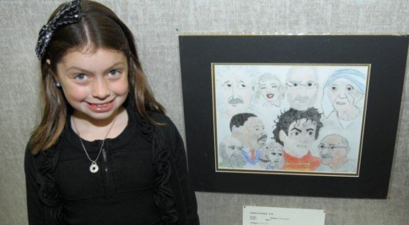 "Sophia Hunsaker with her picture ""Diversity Brings Out Our Best"" (Photo: Jon Clark)"