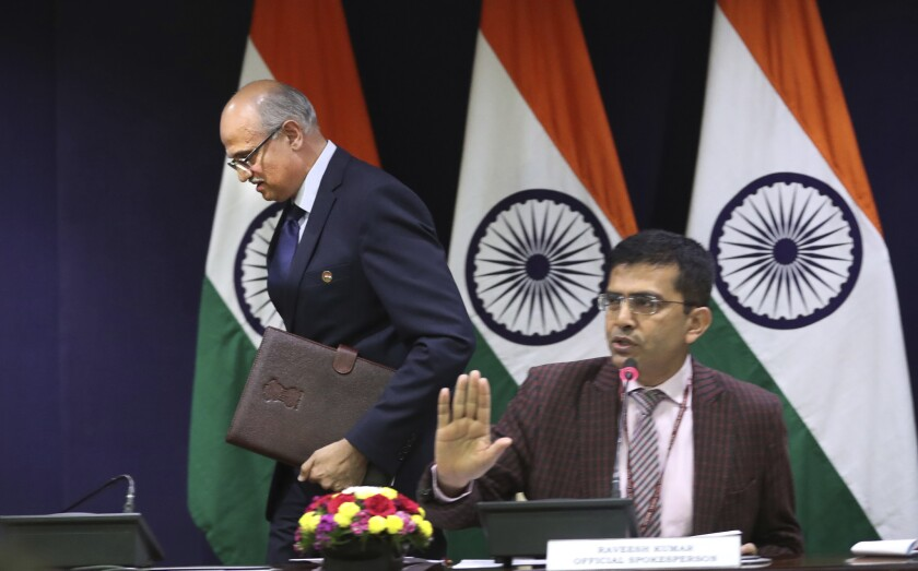 India's foreign ministry spokesperson Raveesh Kumar, right, refuses to entertain questions as foreign secretary Vijay Gokhale leaves after briefing the media about India's air strikes in Pakistan at the Indian foreign ministry in New Delhi, India, Tuesday, Feb.26, 2019.