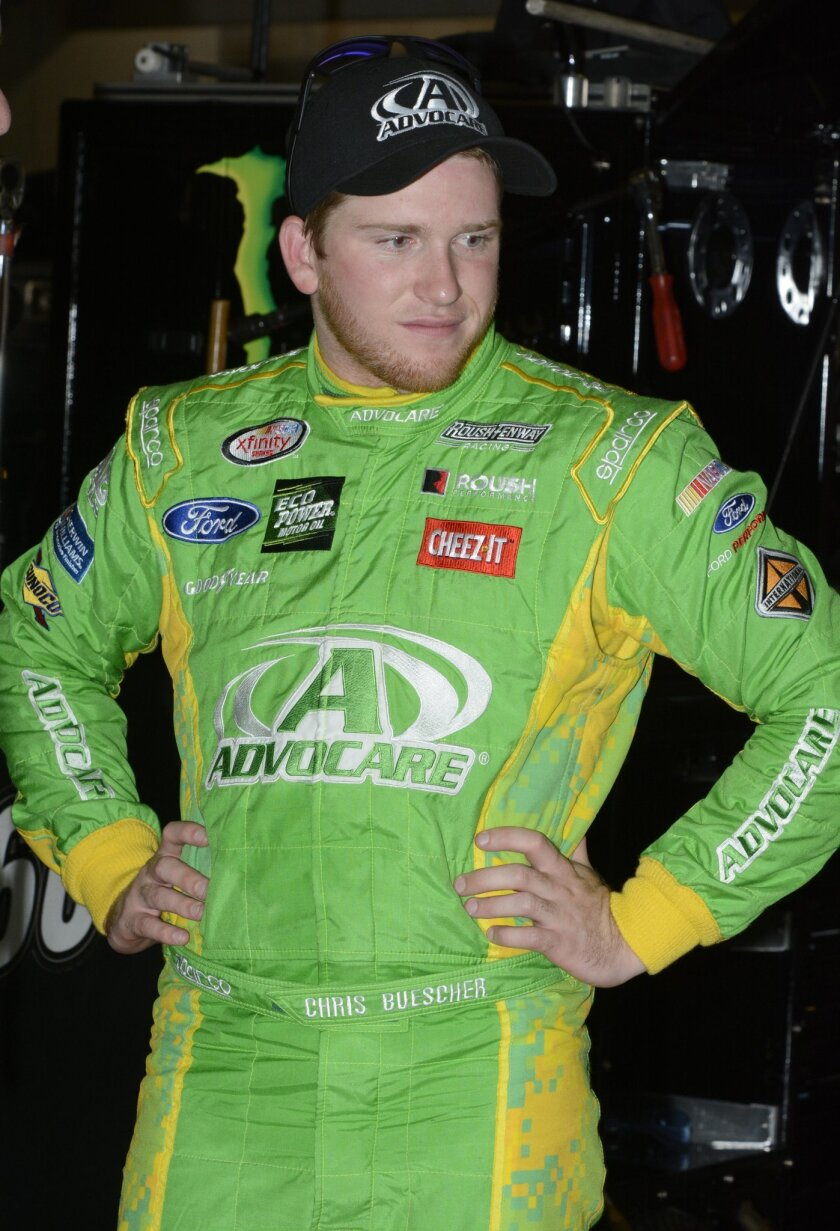 Chris Buescher stands in the garage after the NASCAR Xfinity auto race practice at Texas Motor Speedway, Friday, Nov. 6, 2015, in Fort Worth, Texas. (AP Photo/Larry Papke)