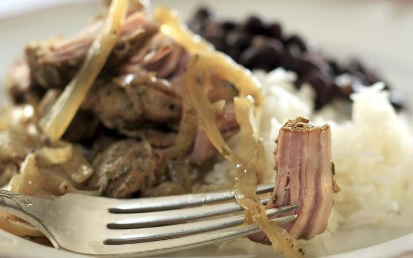 Break out your old slow-cooker with this Cuban-style pork shoulder recipe.