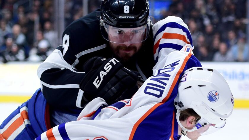 The Kings' Drew Doughty, top, pushes Edmonton's Connor McDavid on Feb. 25, 2016, at Staples Center.