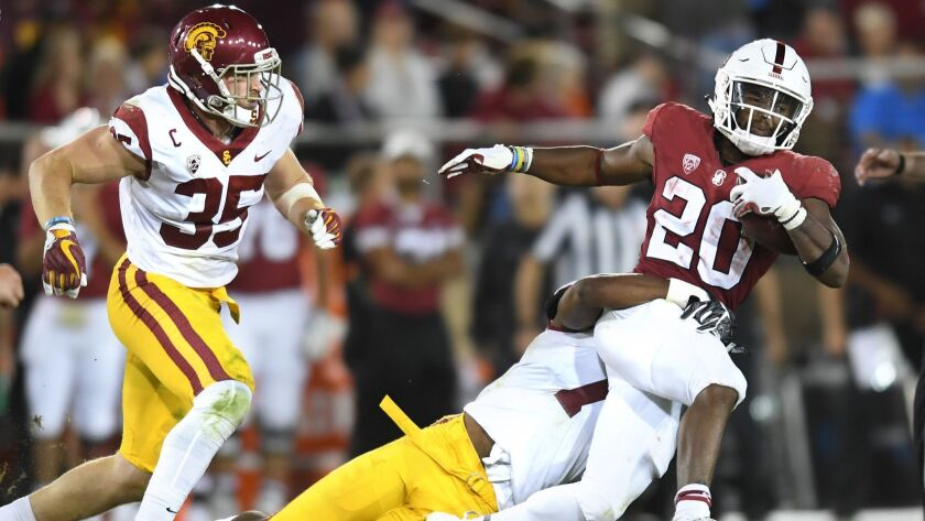 PALO ALTO, CALIFORNIA SEPTEMBER 8, 2018-Stanford running back Bryce Love picks up 5-yards as he is t