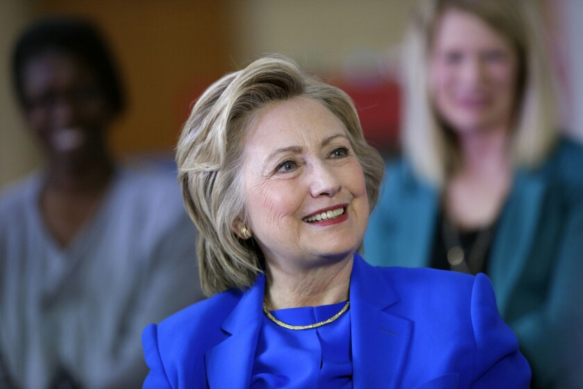 Democratic presidential candidate Hillary Clinton speaks with young parents during a roundtable discussion at the Family Care Center in Lexington, Ky. on May 10.