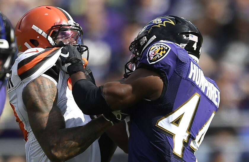 Baltimore Ravens cornerback Marlon Humphrey, right, and Cleveland Browns receiver Odell Beckham scuffle during the second half of a game Sept. 29 in Baltimore.