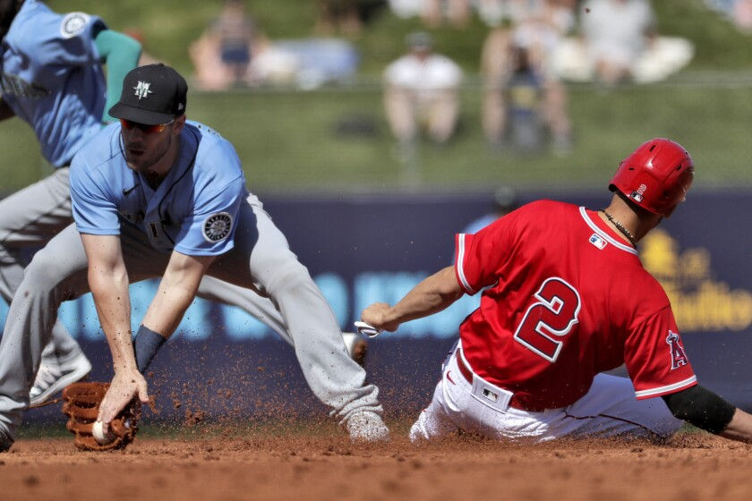 Angels' Andrelton Simmons (2) steals second base as Seattle Mariners' Patrick Wisdom catches the late throw during the second inning of a spring training game on March 4, 2020, in Tempe, Ariz.