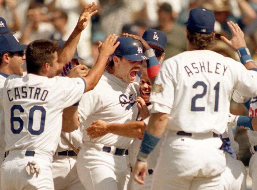 Mike Piazza is swarmed by his Dodgers teammates after hitting a game-winning homerun against Houston in 1996.