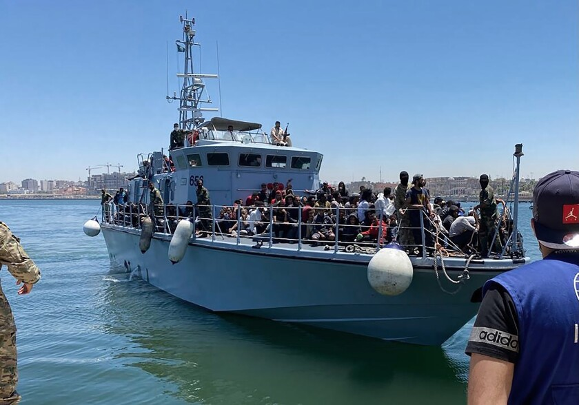 In this June 15, 2021, photo released by the IOM, more than 270 migrants are returned by boat to the port of Tripoli in Libya after they were intercepted by the commercial vessel Vos Tritan a day previous. The International Organization for Migration and the UNHCR have said in a joint statement that migrants intercepted at sea should not be returned to the country, calling it unsafe. (IOM via AP)