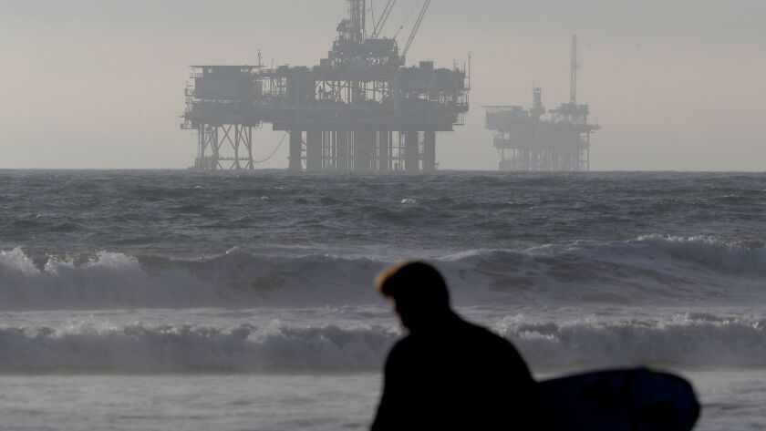 Offshore oil drilling platforms along the California coastline are seen from Huntington Beach.