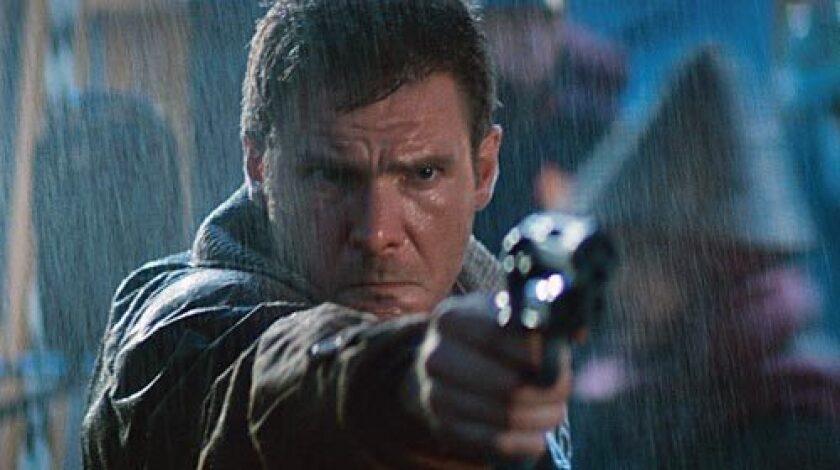 "Harrison Ford pointing a gun in ""Blade Runner."""