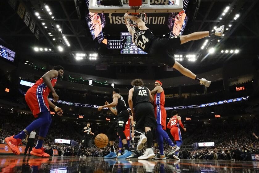 Milwaukee Bucks' Pat Connaughton dunks during the second half of an NBA basketball game against the Philadelphia 76ers Thursday, Feb. 6, 2020, in Milwaukee. The Bucks won 112-101. (AP Photo/Morry Gash)