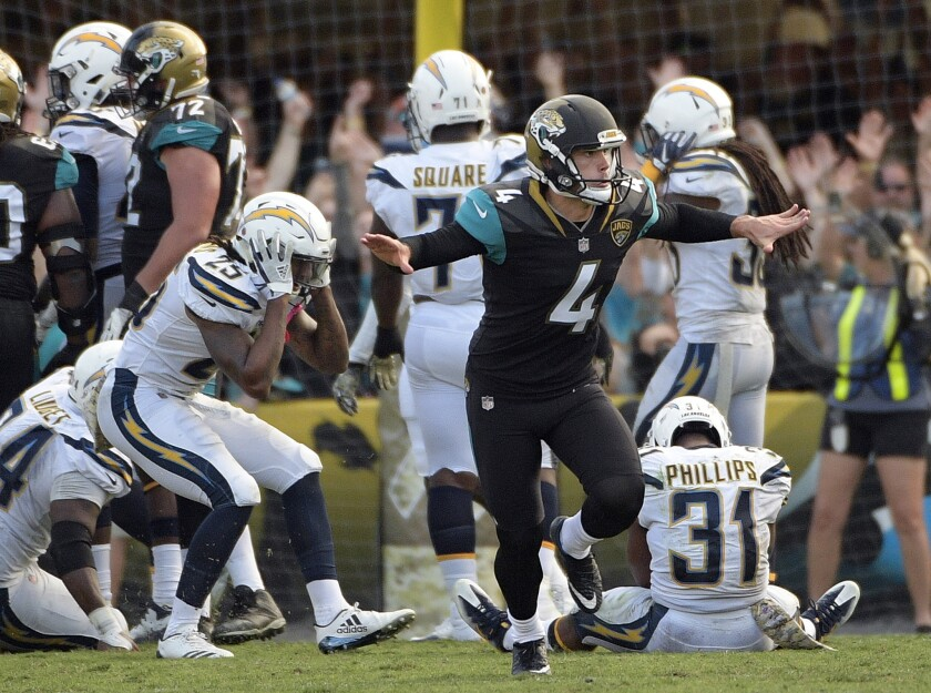 Jacksonville Jaguars kicker Josh Lambo (4) celebrates his game winning field goal as Los Angeles Chargers players including safety Rayshawn Jenkins (25) and safety Adrian Phillips (31) react during the second half of game on Nov. 12, 2017, in Jacksonville, Fla. Jacksonville won 20-17 in overtime.