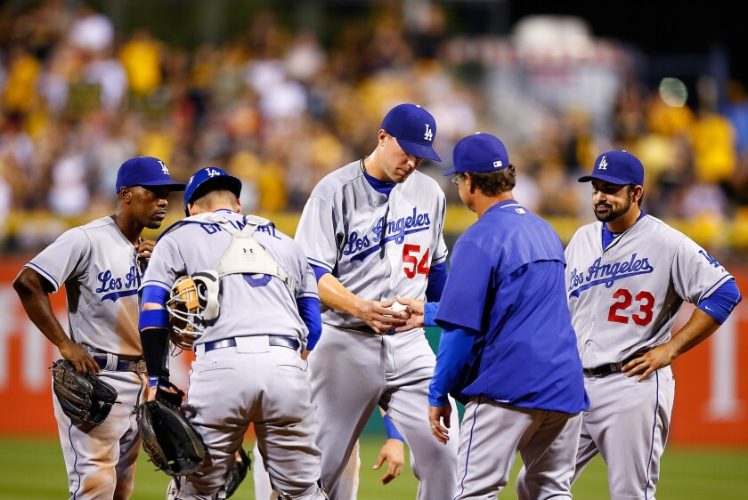 Dodgers Manager Don Mattingly replaces reliever Jim Johnson in the seventh inning, when the Pirates scored nine runs.
