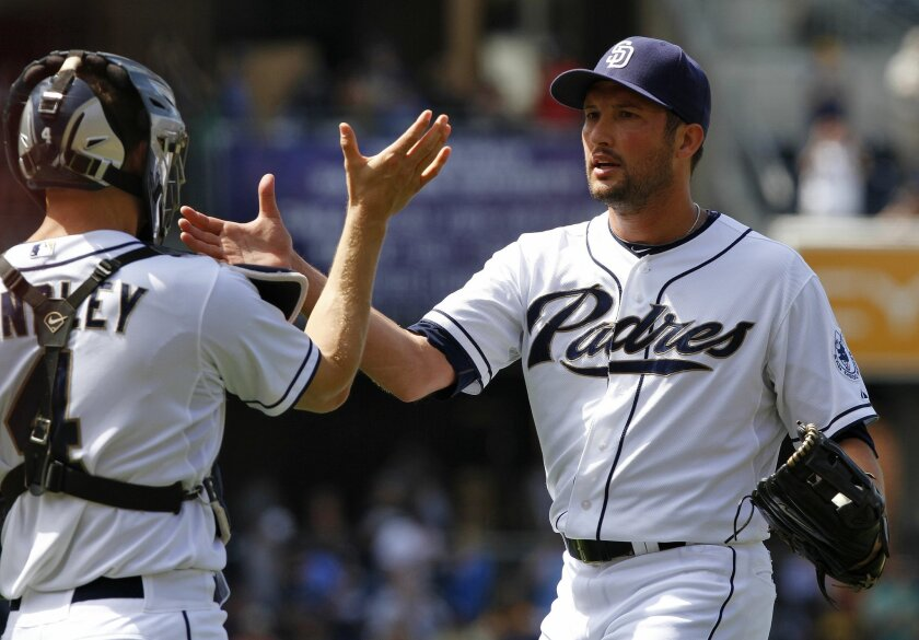 Padres' catcher Nick Hundley and pitcher Huston Street celebrate their 1-0 win over the Miami Marlins on Wednesday.