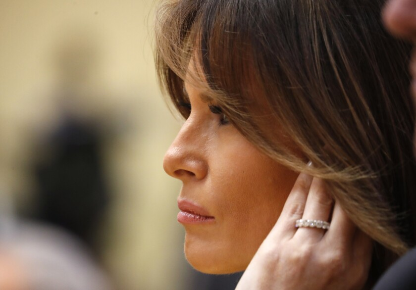 First Lady Melania Trump listens during a press conference after the meeting of President Trump and Russian President Vladimir Putin Helsinki last month.