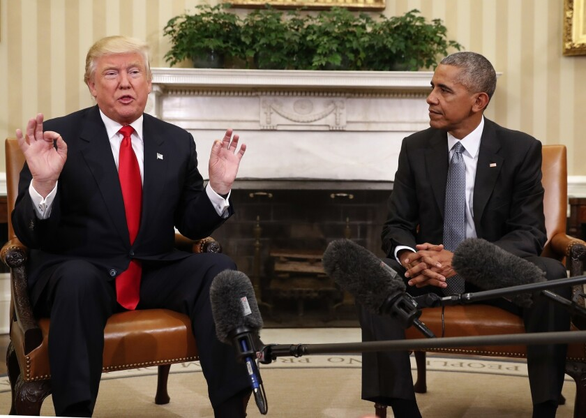 President-elect Donald Trump, left, speaks next to President Obama after meeting in the Oval Office on Thursday.