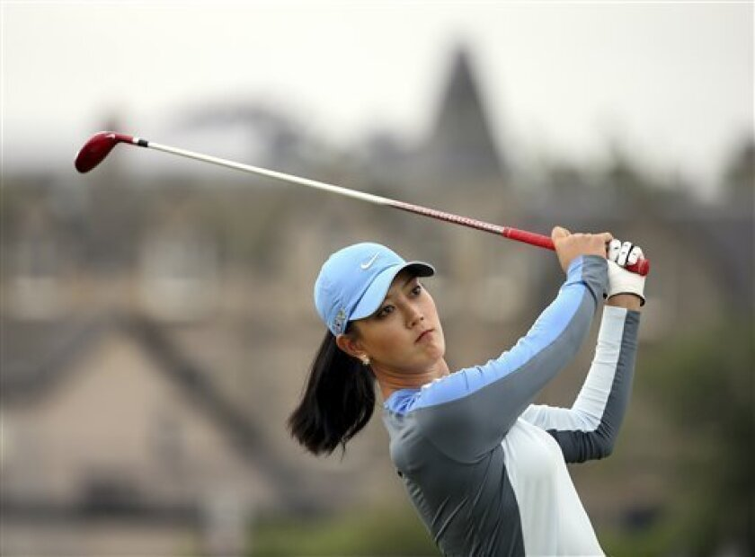 Michelle Wie of the USA tees off on the second during the second round of the Women's British Open golf championship on the Old Course at St Andrews, Scotland, Friday Aug. 2, 2013. (AP Photo/Scott Heppell)