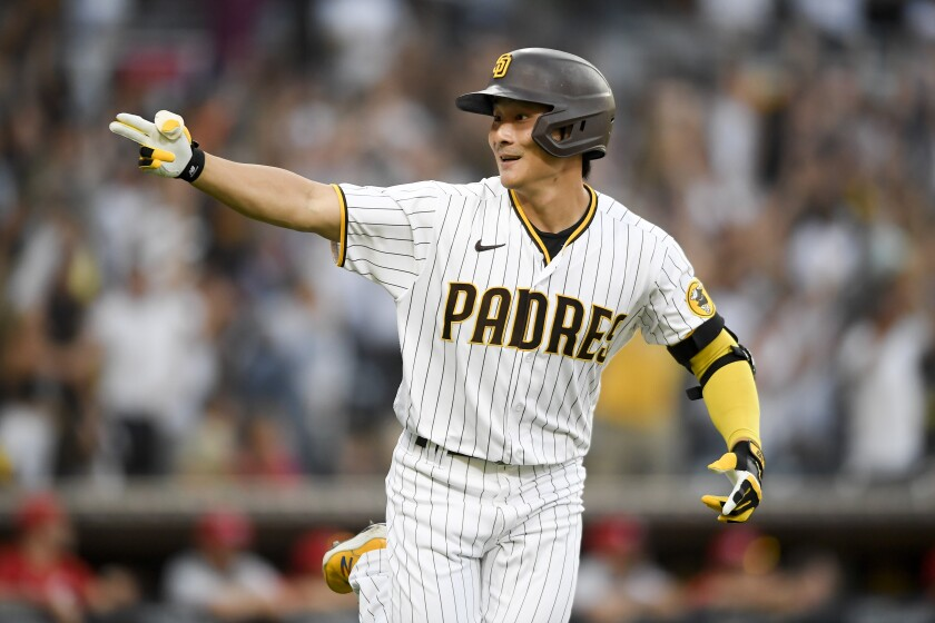 The Padres' Ha-seong Kim reacts towards the dugout after hitting a two-run home run