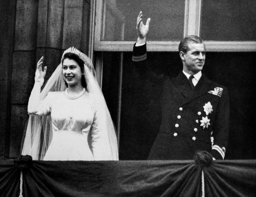 Princess Elizabeth and Prince Philip, Duke of Edinburgh make a charming picture as they wave to the