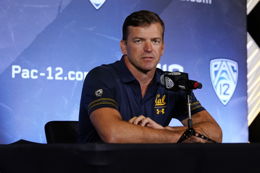 FILE - In this July 27, 2021, file photo, California head coach Justin Wilcox fields questions during the Pac-12 Conference NCAA college football Media Day in Los Angeles. After a pandemic-shortened 2020 season, the California Golden Bears are excited to show off what they hope will be a much more dynamic offense with respected longtime NFL coordinator Bill Musgrave and veteran quarterback Chase Garbers. Coach Justin Wilcox brought on Musgrave last season to build on a strong finish to 2019 only to have spring practice cut short after only a few sessions because of the COVID-19 pandemic. (AP Photo/Marcio Jose Sanchez, File)